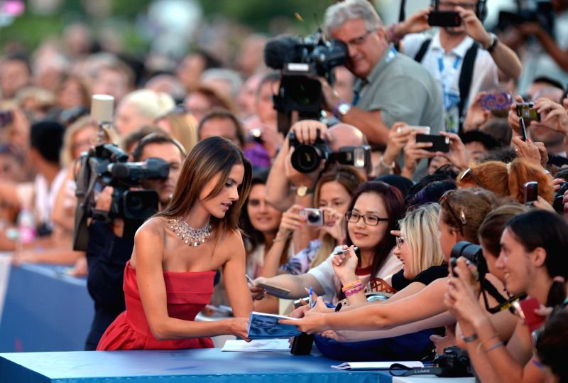 "Brazilian model Alessandra Ambrosio (L) reacts with fans on the red carpet for the selected film for main competition ""La Rancon La Gloire"" during the 71th - Alessandra Ambrosio"