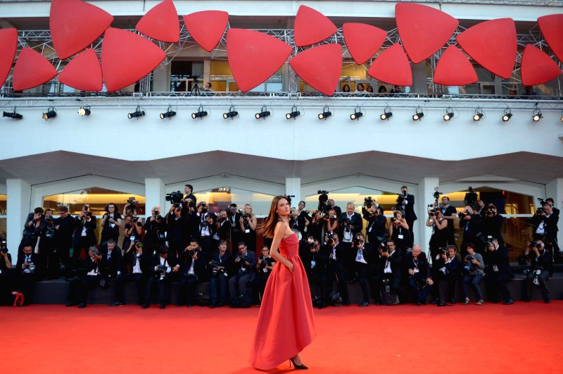 "Brazilian model Alessandra Ambrosio poses on the red carpet for the selected film for main competition ""La Rancon de La Gloire"" during the 71st Venice Film - Alessandra Ambrosio"