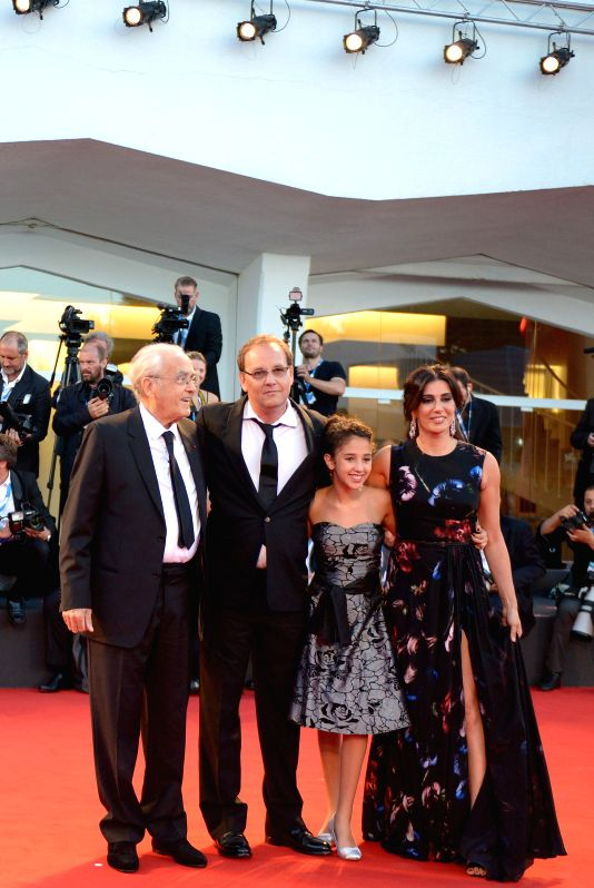 Director Xavier Beauvois (2nd L), actress Nadine Labaki (1st R) and music composer Michel Legrand (1st L) pose on the red carpet for the selected film for main ... - Nadine Labaki