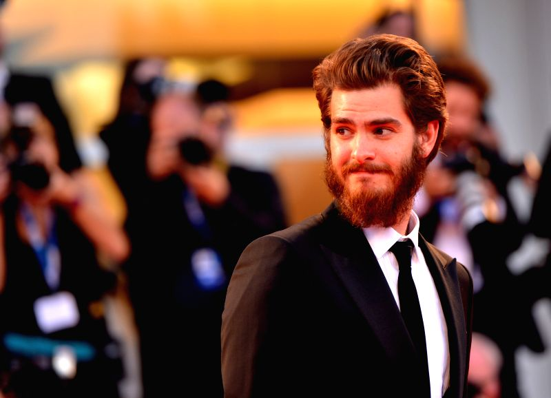 """Actor Andrew Garfield poses on the red carpet for """"99 Homes"""" which is selected for the main competition during the 71st Venice Film Festival, in Lido of ... - Andrew Garfield"""