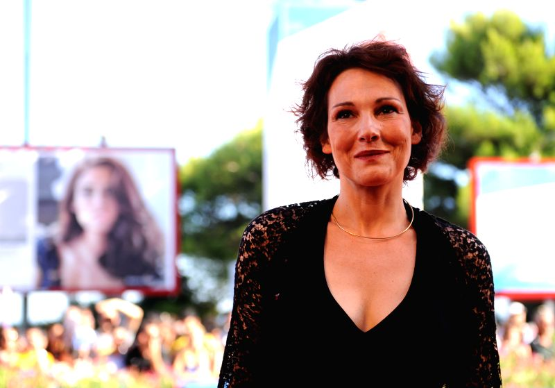 """Actress Anna Ferruzzo poses on the red carpet for the film """"Anime Nere"""" (Black Souls) during the 71st Venice Film Festival, in Lido of Venice, Italy on ... - Anna Ferruzzo"""