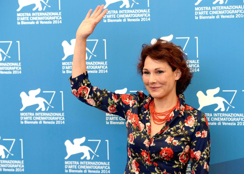 Actress Anna Ferruzzo poses during the photo call for the selected film for main competition Anime Nere during the 71th Venice Film Festival, in Lido of Venice, ... - Anna Ferruzzo