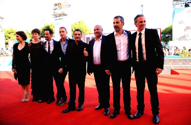 Director Francesco Munzi (2nd R) and cast members Giuseppe Fumo (4th L), Marco Leonardi (4th R), Anna Ferruzzo (1st L), Barbora Bobulova (2nd L), Fabrizio Ferracane .