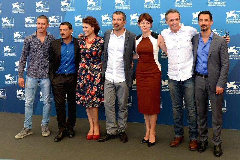 Director Francesco Munzi (C) and cast members Giuseppe Fumo, Marco Leonardi, Anna Ferruzzo, , Barbora Bobulova, Fabrizio Ferracane and Peppino Mazzotta (L-R) pose ...