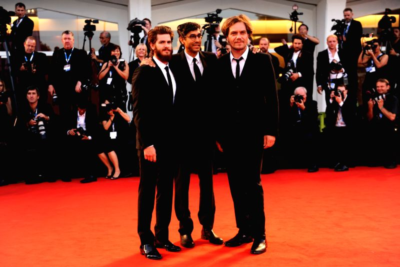 """(From L to R) Actor Andrew Garfield, director Ramin Bahrani and actor Michael Shannon pose on the red carpet for """"99 Homes"""" which is selected for the main . - Andrew Garfield"""