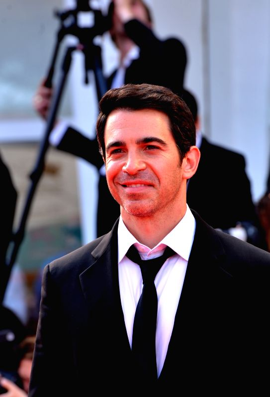 "Actor Chris Messina poses on the red carpet for ""Manglehorn"" during the 71st Venice Film Festival in Lido of Venice, Italy, Aug. 30, 2014. (Xinhua/Xu ... - Chris Messina"