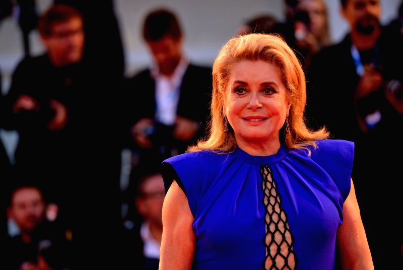"Actress Catherine Deneuve poses on the red carpet for ""3 Coeurs"" during the 71st Venice Film Festival, in Lido of Venice, Italy on Aug. 30. 2014. ... - Catherine Deneuve"