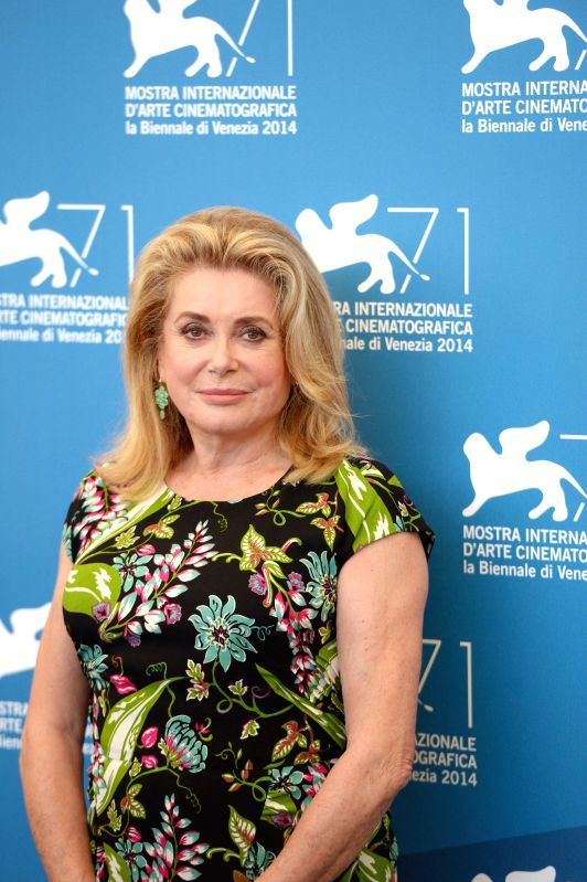 Actress Catherine Deneuve poses during the photo call for 3 Coeurs during the 71st Venice Film Festival, in Lido of Venice, Italy on Aug. 30. 2014. Photo: ... - Catherine Deneuve