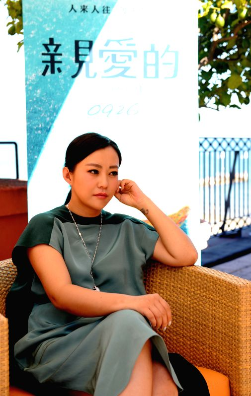 Actress Hao Lei speaks to the media for the movie Qin Ai De (Dearest) during the 71st Venice Film Festival, in Lido of Venice, Italy on Aug. 29. 2014. The 71st ... - Hao Lei