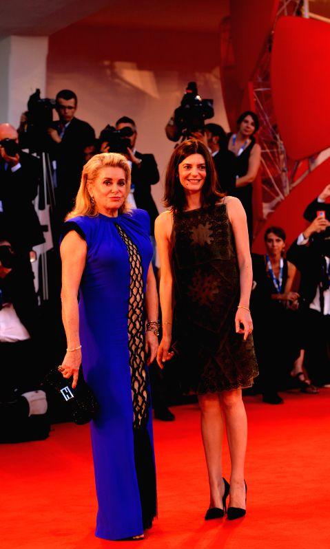 "Actresses Chiara Mastroianni(R) and Catherine Deneuve pose on the red carpet for ""3 Coeurs"" during the 71st Venice Film Festival, in Lido of Venice, Italy . - Chiara Mastroianni"