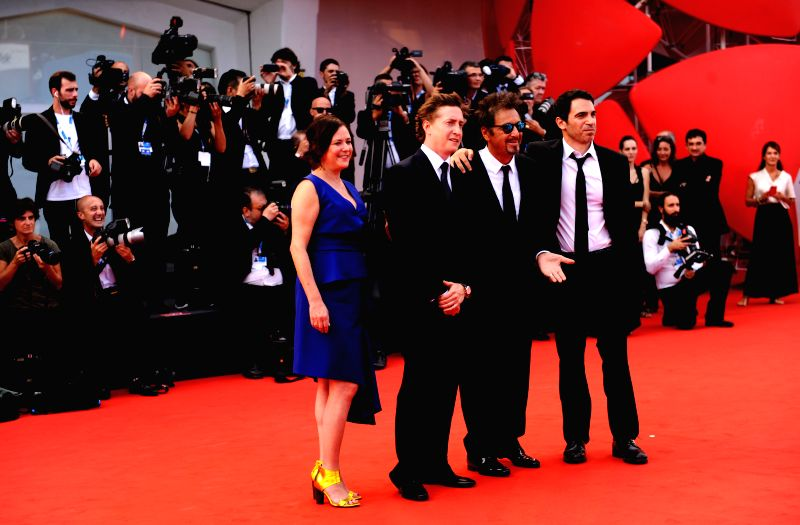 "Director David Gordon Green (2nd L) and actor Al Pacino (2nd R), Chris Messina(1st R) pose on the red carpet for ""Manglehorn"" during the 71st Venice Film .."