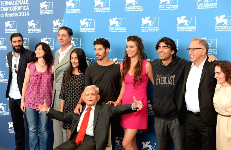 "Director Fatih Akin (3rd R), writer Mardik Martin (front) and actor Tahar Rahim (C, rear) and other cast members pose during the photo call for ""The Cut"" .. - Tahar Rahim"