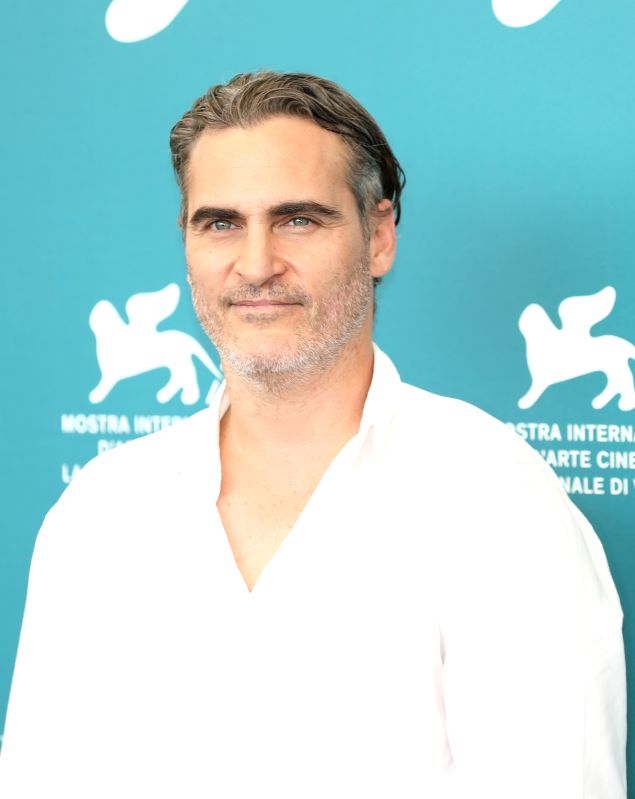 "VENICE, Aug. 31, 2019 (Xinhua) -- Actor Joaquin Phoenix attends a photocall for the film ""Joker"" during the 76th Venice International Film Festival in Venice, Italy, on Aug. 31, 2019. (Xinhua/Cheng Tingting/IANS)"