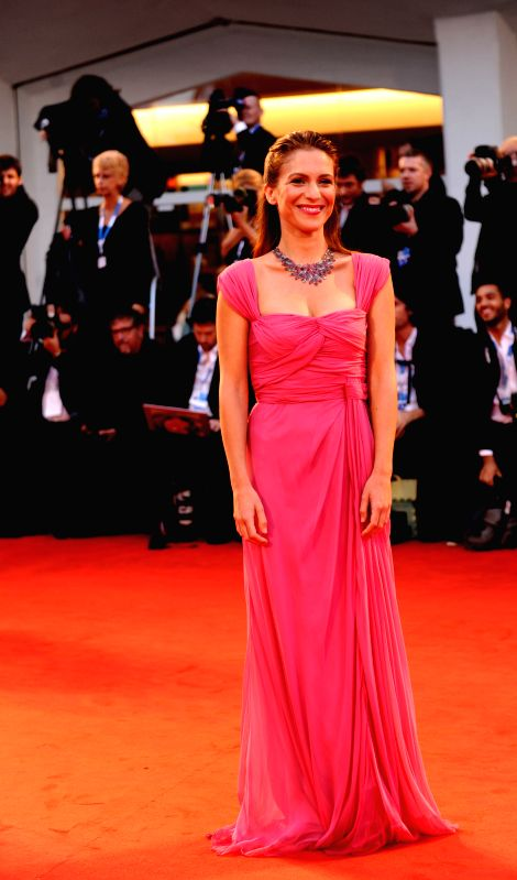 """Actress Isabella Ragonese poses on the red carpet for """"Il giovane favoloso"""" which is selected for the main competition during the 71st Venice Film ... - Isabella Ragonese"""