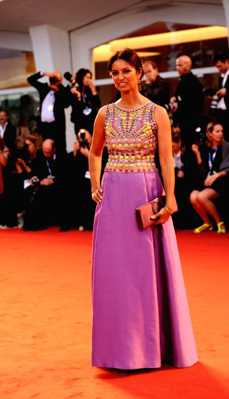 """Member of the jury Jhumpa Lahiri poses on the red carpet for """"Il giovane favoloso"""" which is selected for the main competition during the 71st Venice Film .."""