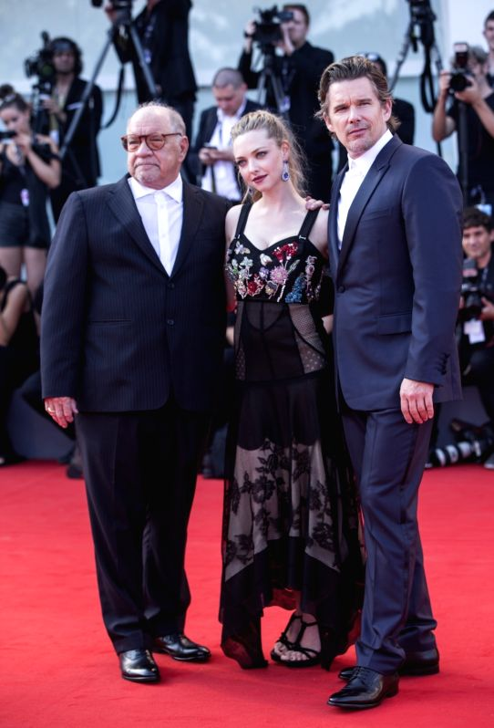 "VENICE, Sept. 1, 2017 - Actor Ethan Hawke (R), actress Amanda Seyfried (C) and director Paul Schrader arrive for the premiere of the movie ""First Reformed"" at the 74th Venice Film Festival ... - Ethan Hawke"