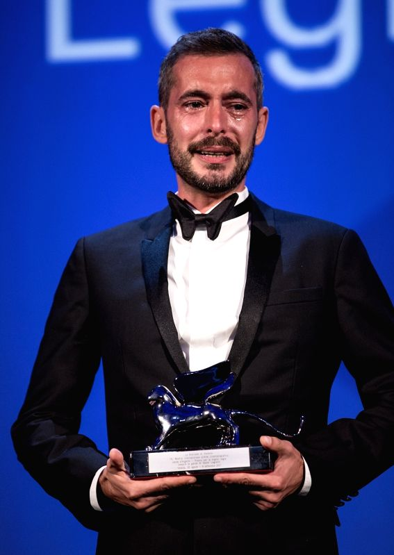 "VENICE, Sept. 10, 2017 - Xavier Legrand holds the Silver Lion for Best Director for the movie ""Jusqu'a la garde"" during the award ceremony at the 74th Venice Film Festival, at the Lido of ..."