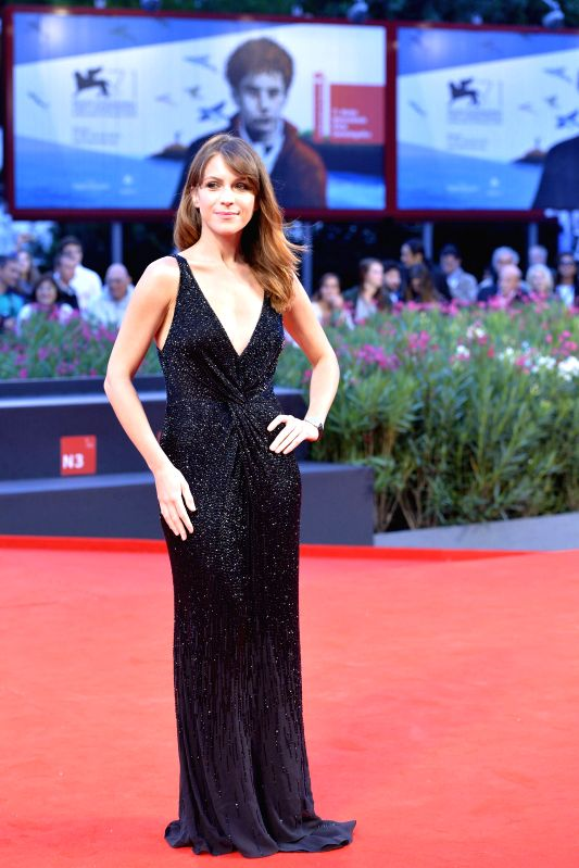 Italian actress Isabella Ragonese poses on red carpet during the 71th Venice Film Festival, in Lido of Venice, Italy on Sept. 2, 2014. - Isabella Ragonese