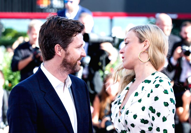 """VENICE, Sept. 2, 2017 - Director Andrew Haigh (L) and actress Chloe Sevigny arrive for the premiere of the movie """"Lean on Pete"""" at the 74th Venice Film Festival in Venice, Italy, on Sept. ... - Chloe Sevigny"""