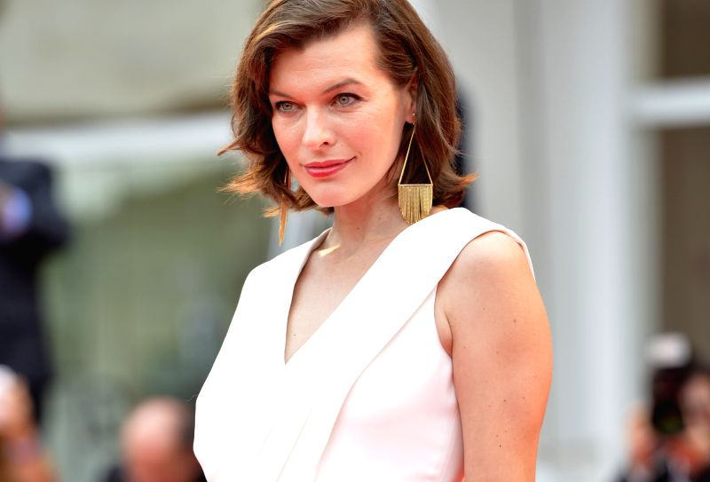 """VENICE, Sept. 3, 2014 (Xinhua) -- Actress Milla Jovovich poses on the red carpet for the movie """"Cymbeline"""" during the 71st Venice Film Festival, in Lido of Venice, Italy, Sept. 3, 2014. (Photo: Xinhua/Liu Lihang/IANS)"""