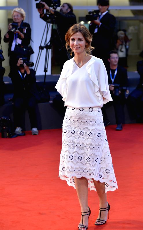 "French director Alix Delaporte poses on the red carpet for ""Le dernier coup de marteau"" which is selected for the main competition during the 71th Venice .."