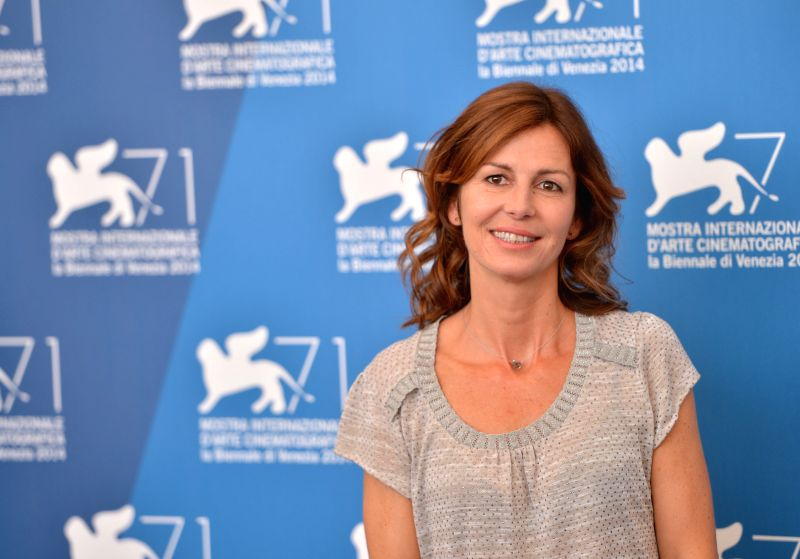 "French director Alix Delaporte poses at the photocall for the movie ""Le dernier coup de marteau"" during the 71st Venice Film Festival, in Lido of Venice, .."
