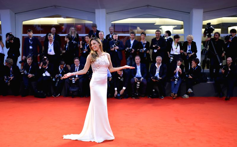 "Italian singer Anna Tatangelo poses during the red carpet for ""Le dernier coup de marteau"" which is selected for the main competition during the 71th ..."