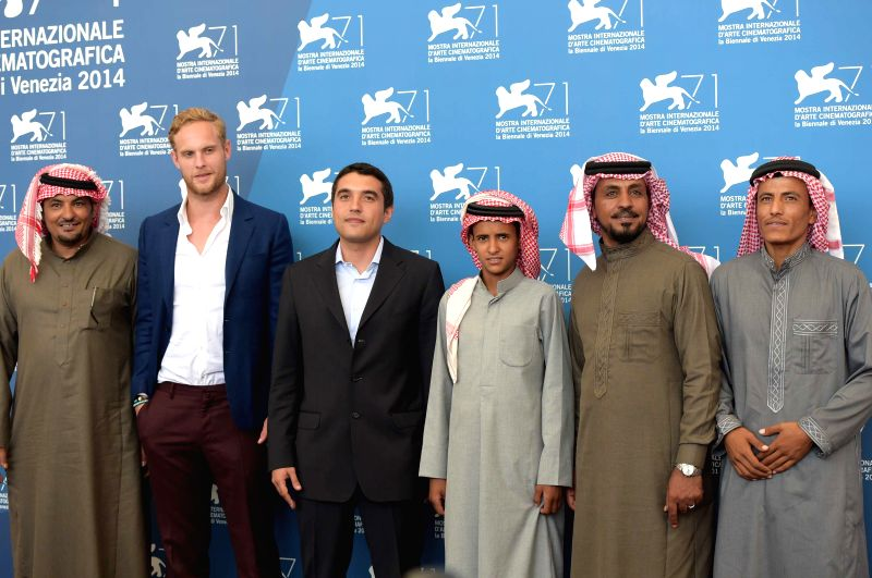 """Actor Jack Fox (2nd L), director Naji Abu Nowar (3rd L), actor Jacir Eid (4th L) and other cast members pose during the photo call for """"Theeb"""" which is ... - Jack Fox"""