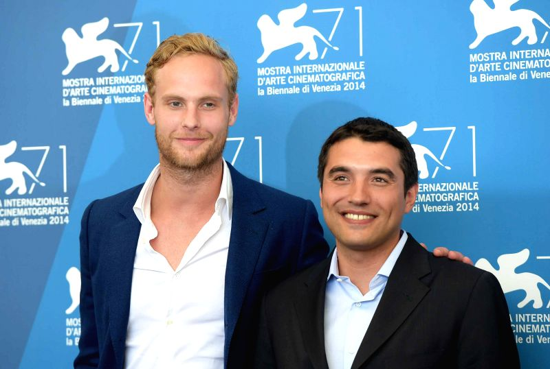 """Actor Jack Fox (L) and director Naji Abu Nowar pose during the photo call for """"Theeb"""" which is selected for the horizons competition during the 71st Venice - Jack Fox"""