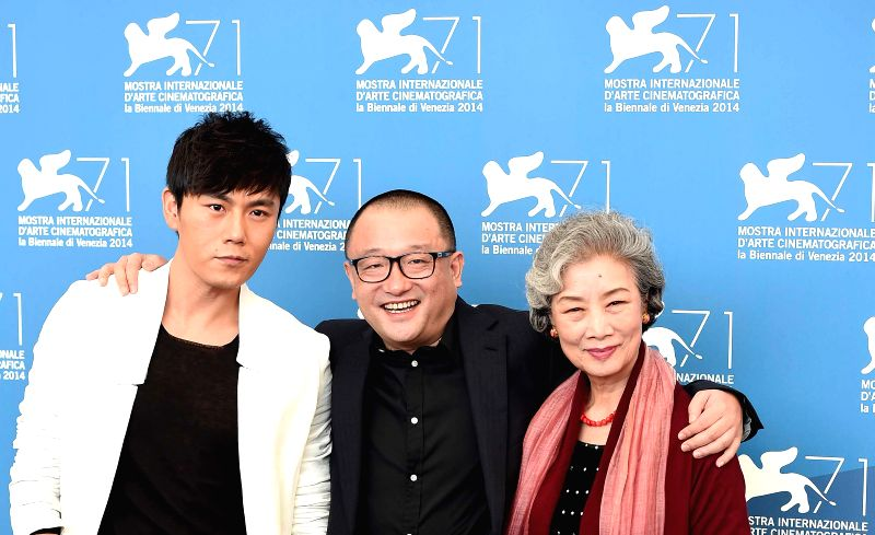 """Actor Qin Hao, director Wang Xiaoshuai and actress Lu Zhong (from L to R) pose during the photo call for """"Red Amnesia"""" which is selected for the main ... - Qin Hao"""