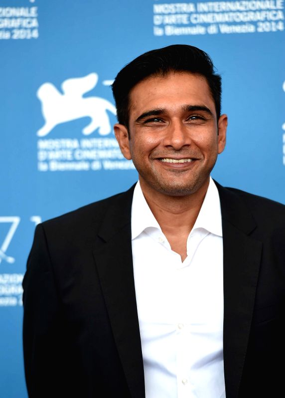 """Actor Vivek Gomber poses during the photo call for """"Court"""" which is selected for the horizons competition during the 71th Venice Film Festival, in Lido of . - Vivek Gomber"""