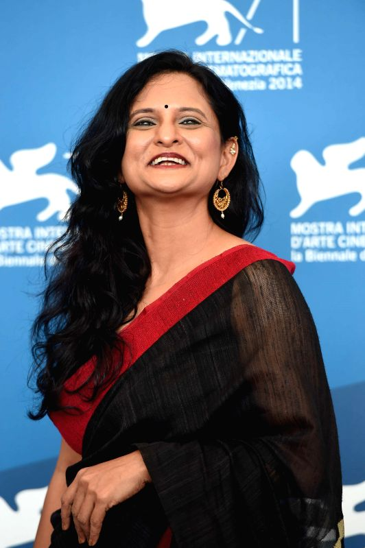 """Actress Geetanjali Kulkarni poses during the photo call for """"Court"""" which is selected for the horizons competition during the 71th Venice Film Festival, in - Geetanjali Kulkarni"""
