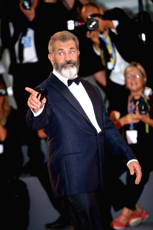 "VENICE, Sept. 5, 2016 (Xinhua) -- Director Mel Gibson arrives for the premiere of the movie ""Hacksaw Ridge"" at the 73rd Venice Film Festival in Venice, Italy, Sept. 4, 2016. (Xinhua/Jin Yu/IANS)"