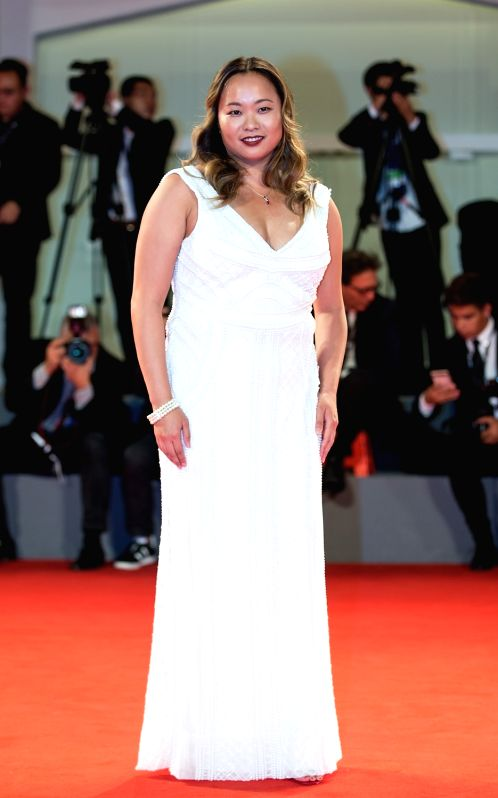 """VENICE, Sept. 9, 2017 - Actress Angeles Woo attends the red carpet event of the movie """"Zhuibu (Manhunt)"""" at the 74th Venice Film Festival in Venice, Italy, Sept. 8, 2017. - Angeles Woo"""
