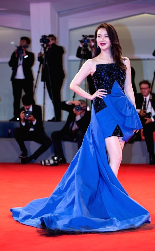 """VENICE, Sept. 9, 2017 - Actress Qi Wei attends the red carpet event of the movie """"Zhuibu (Manhunt)"""" at the 74th Venice Film Festival in Venice, Italy, Sept. 8, 2017. - Q"""