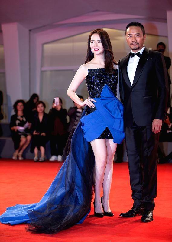 """VENICE, Sept. 9, 2017 - Actress Qi Wei (L) and actor Zhang Hanyu attend the red carpet event of the movie """"Zhuibu (Manhunt)"""" at the 74th Venice Film Festival in Venice, Italy, Sept. 8, 2017. - Q"""