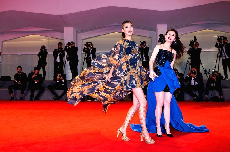 "VENICE, Sept. 9, 2017 - Actresses Qi Wei (R) and Okamoto Tao attend the red carpet event of the movie ""Zhuibu (Manhunt)"" at the 74th Venice Film Festival in Venice, Italy, Sept. 8, 2017. - Q"