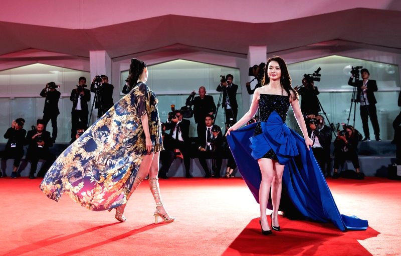 """VENICE, Sept. 9, 2017 - Actresses Qi Wei (R) and Okamoto Tao attend the red carpet event of the movie """"Zhuibu (Manhunt)"""" at the 74th Venice Film Festival in Venice, Italy, Sept. 8, 2017. - Q"""