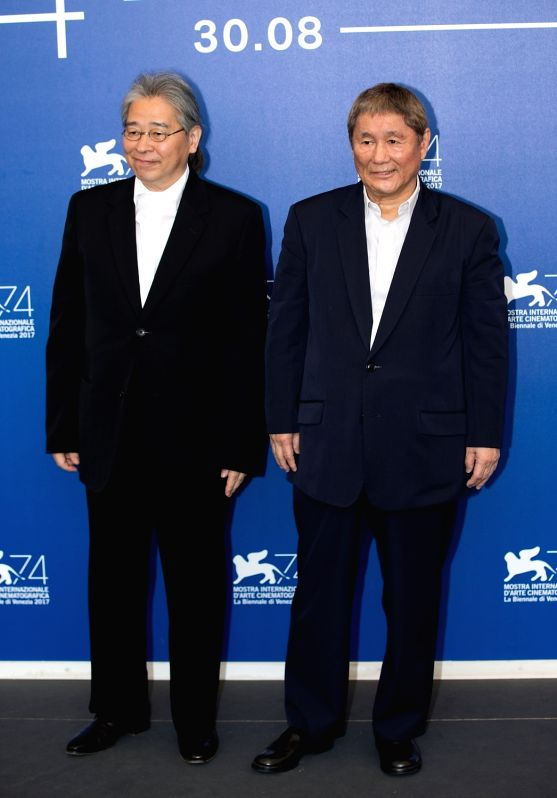 "VENICE, Sept. 9, 2017 - Director Takeshi Kitano (R) and producer Masayuki Mori attend a photocall for the film ""Outrage Coda"" during the 74th Venice Film Festival at Lido island in Venice, ..."
