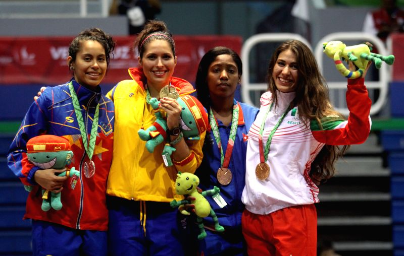 Gold medalist Saskia Loretta van Erven Garcia (2nd, L) of Colombia, silver medalist Isis Gimenez (1st, L) of Venezuela and bronze medalists Angela Winter (2nd, R) of Cuba and Arely ...