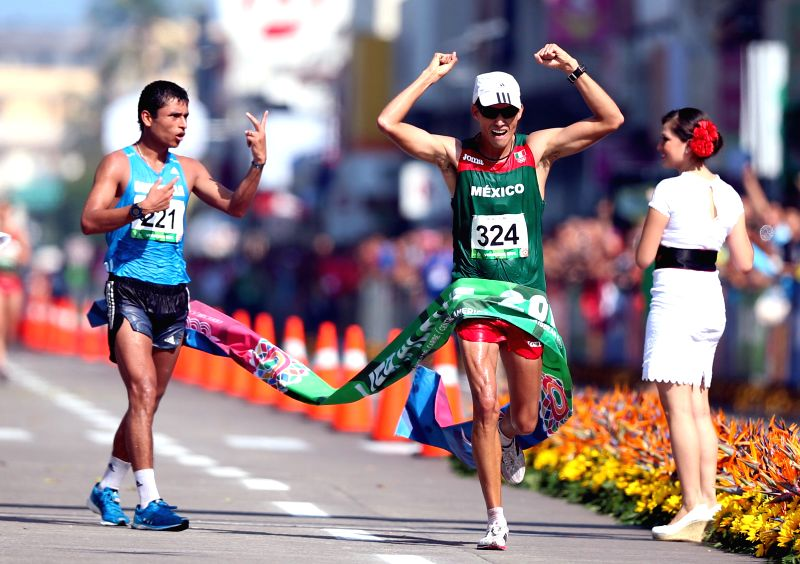 Mexican athlete Horacio Nava crosses the finish line of the men's 20km hiking competition at the 2014 Veracruz Central American and Caribbean Games in Veracruz, Mexico, on Nov. 23, 2014. ...