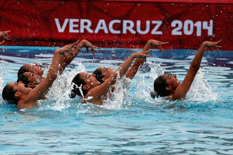 Mexico's players compete during the free routine competition of synchronized swimming at 2014 Veracruz Central American and Caribbean Games in Boca del Rio, Veracruz, Mexico, on Nov. 19, ...
