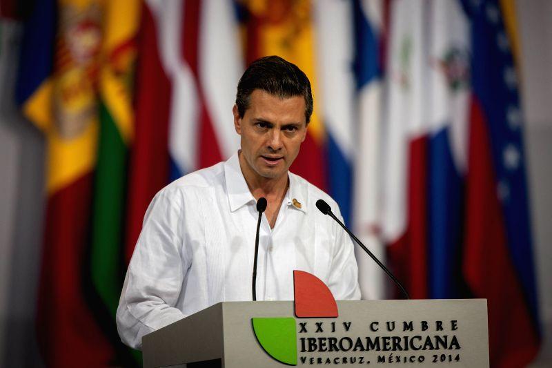 Mexico's President Enrique Pena Nieto addresses a press conference at the end of the 24th Ibero-American Summit 2014 in Boca del Rio of Veracruz, Mexico, on Dec. 9, 2014. Photo: ...