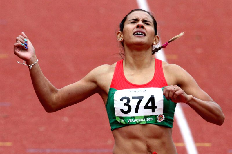 Mexico's Zudikey Rodriguez competes during the women's 400m hurdles competition at the 2014 Veracruz Central American and Caribbean Games in Xalapa, Veracruz, Mexico, on Nov. 26, 2014. ...