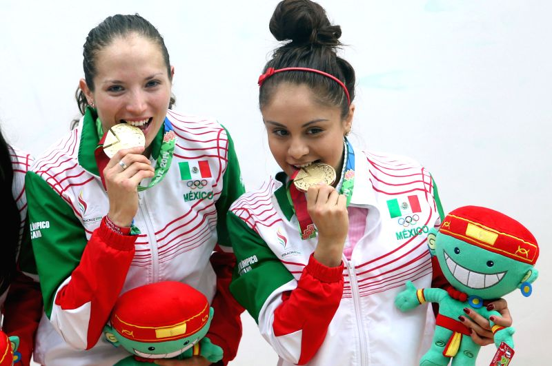 Paola Longoria (R) and Samantha Salas of Mexico pose during the awarding ceremony of women's team racquetball, in the  2014 Veracruz Central American and Caribbean Games in Boca del Rio, ...