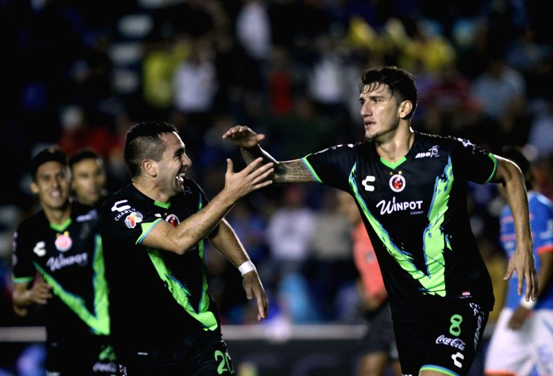 Veracruz's Gabriel Penalba (R) celebrates after scoring with his teammates during the match of Day 15 of Opening Tournament of MX League against Cruz Azul, at ...