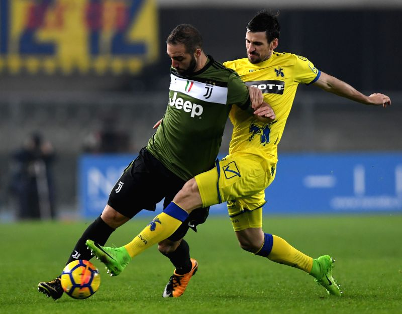 VERONA, Jan. 28, 2018 - Juventus' Gonzalo Higuain (L) vies with Chievo's Nenad Tomovic during the Italian Serie A soccer match between Juventus and Chievo in Verona, Italy, Jan. 27, 2018. Juventus ...