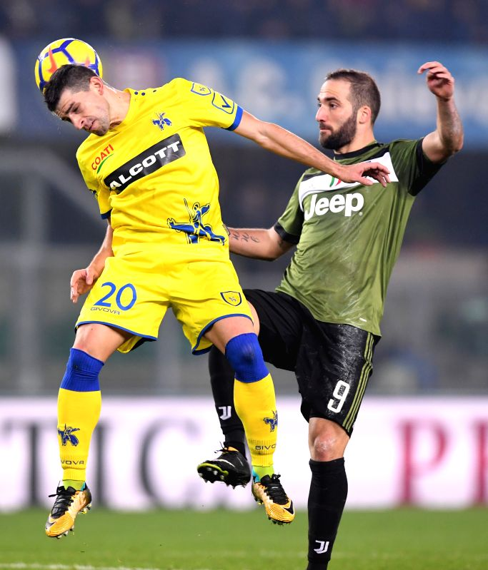 VERONA, Jan. 28, 2018 - Juventus' Gonzalo Higuain (R) vies with Chievo's Manuel Pucciarelli during the Italian Serie A soccer match between Juventus and Chievo in Verona, Italy, Jan. 27, 2018. ...