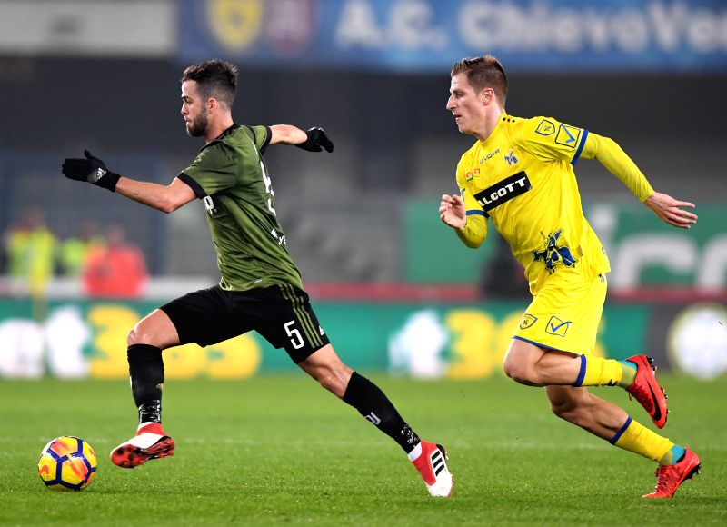 VERONA, Jan. 28, 2018 - Juventus' Miralem Pjanic (L) vies with Chievo's Walter Birsa during the Italian Serie A soccer match between Juventus and Chievo in Verona, Italy, Jan. 27, 2018. Juventus won ...