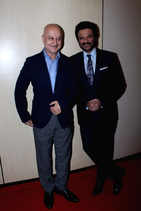 Veteran actor Anupam Kher, along with Anil Kapoor during the Dada Saheb Phalke Academy Awards 2017, in Mumbai on June 1, 2017. - Anupam Kher and Kapoor